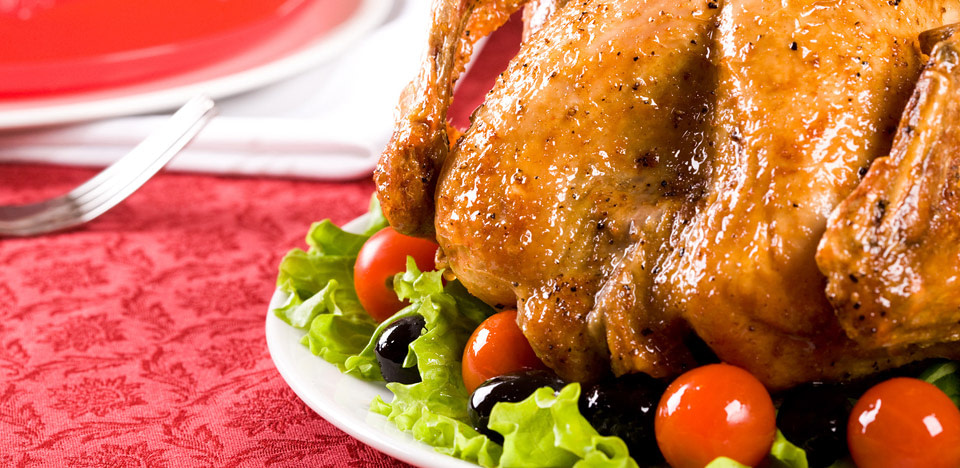 deep fryed turkey served with salad tomatoes and olives